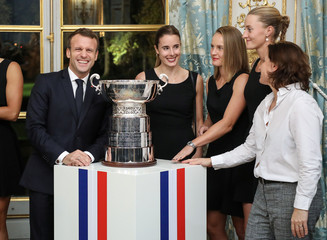 French President Emmanuel Macron, Alize Cornet, Fiona Ferro, Kristina Mladenovic of the French women tennis team and French Sports Minister Roxana Maracineanu pose for a picture during a reception at the Elysee Presidential Palace in Paris