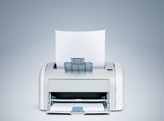 Laser printer with paper front view, on a light blue background. File contains a path to isolation.
