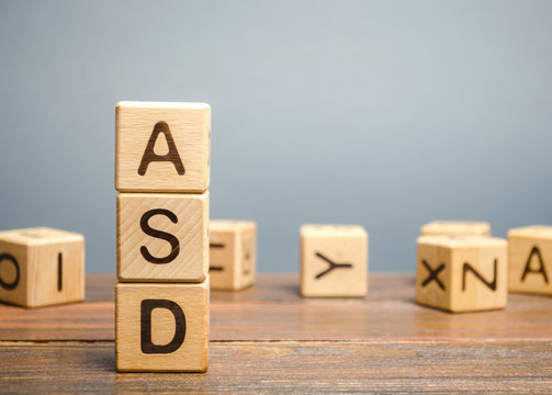 Wooden blocks with the word ASD - Autism Spectrum Disorder. Neurological and developmental disorder