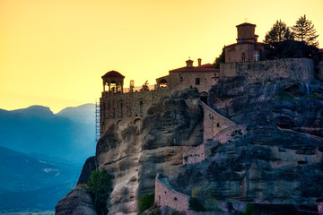Landscape with monasteries and rock formations in Meteora, Greece. during sunset.
