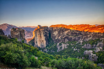 Landscape with monasteries and rock formations in Meteora, Greece. during the sunrise