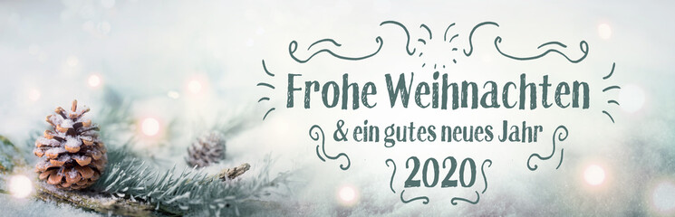 Christmas greetings  2019  2020  -  German language  -  Merry Christmas and Happy New Year  -  Fir branch in sn ow landscape with magic lights