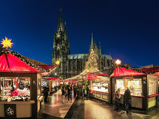 Cologne Cathedral Christmas Market in dusk, Germany. This is the most popular and best-known of all the city markets in front of the famous Cologne Cathedral.