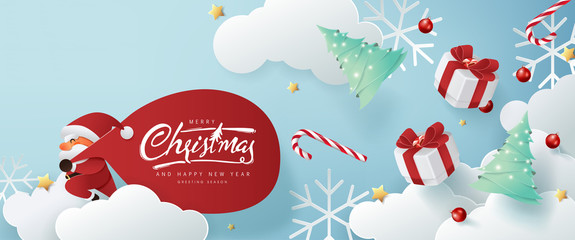 Fototapete - Santa Claus with a huge bag on the run to delivery christmas gifts on white cloud background.Merry Christmas text Calligraphic Lettering Vector illustration.