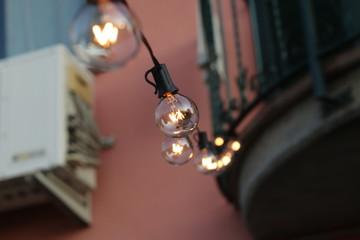 Photo sur cadre textile Vintage voitures beautiful warm light bulb, outdoor party