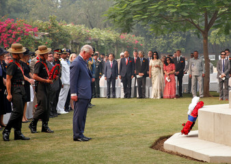 Britain's Prince Charles stands after placing a wreath at a memorial during his visit to Delhi War Cemetery in New Delhi