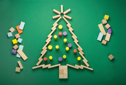 Christmas tree shape made up of toy wooden cubes