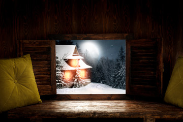 Pillow on window sill and free space for your decoration.Wooden dark background and winter...