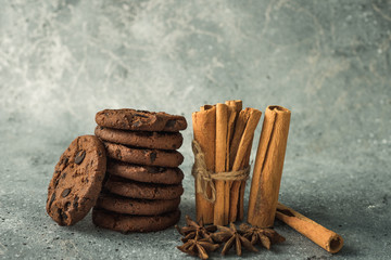 tasty healthy cookies and cinnamon and anise on the table