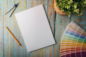 design mockup - blank notebook with color swatch. top view