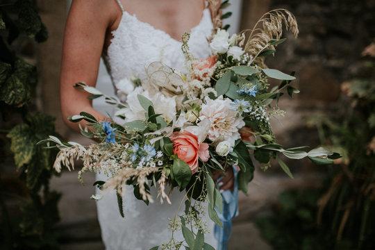 hippie bride holding wild boho bouquet