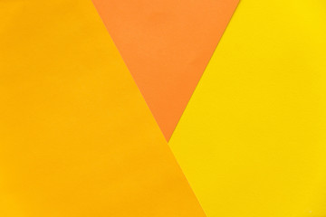 Abstract orange and yellow papers stacking together in abstract form. Abstract color paper background.