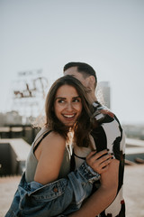 Young couple on rooftop in the city