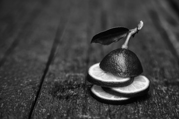 black and white still life, lime on an old,shabby background