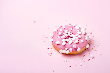 Wall Mural - Pink donut with marshmallows and sprinkled. Minimal concept