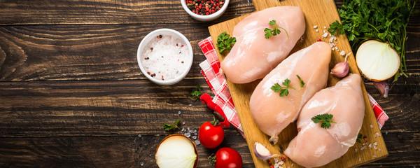 Foto op Aluminium Kip Chicken fillet with ingredient on wooden table.