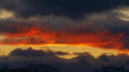 Fotobehang - Epic clouds change from red to blue as sunset sky turns into night. Zoom out. Timelapse, 4K UHD.