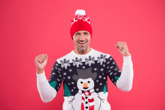 Winter chill get strong. Unshaven guy smile in snowman winter style jumper. Happy man with casual winter look. Warm knitted design for cold weather. Keeping warm and festive during winter holidays