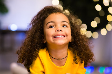 Cheerful afro girl portrait near Xmas tree