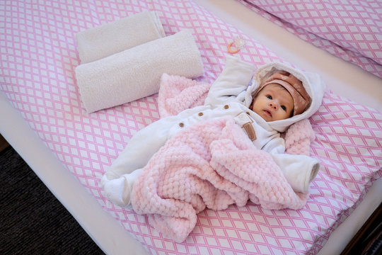 Two months old baby in the bed