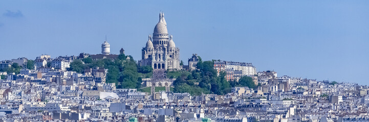 Foto auf Gartenposter Paris Paris, panorama of the city, typical roofs and buildings, with Montmartre and the Sacre-Choeur basilica in background
