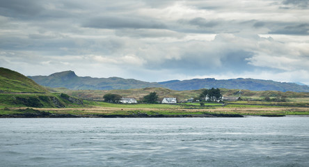 Panoramic view of the cliffs, mountains and valleys of the islands of Inner Hebrides on a cloudy day. Scotland, UK
