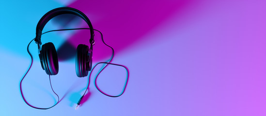 headphones on a black background close-up in neon light