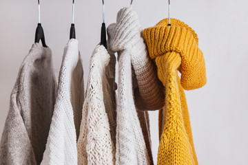 Wall Mural - Warm knitted sweaters on the hangers.