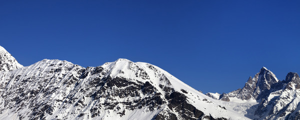 Fototapete - Snowy mountains and blue clear sky at nice sun day