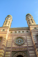 Vertical picture of ornamental front side facade and two onion domes of the Great Synagogue in Hungarian Budapest. Dohany Street Synagogue, the largest synagogue in Europe. Center of Neolog Judaism