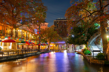 San Antonio River Walk and stone bridge over San Antonio River near Alamo in downtown San Antonio, Texas, USA.