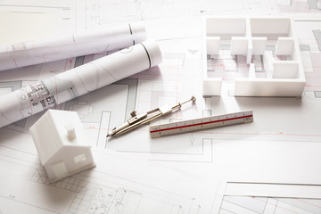 Residential building drawings and architectural model, Construction concept