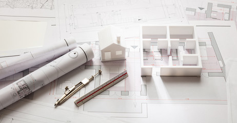 Construction concept. Residential building drawings and architectural model, Fotomurales