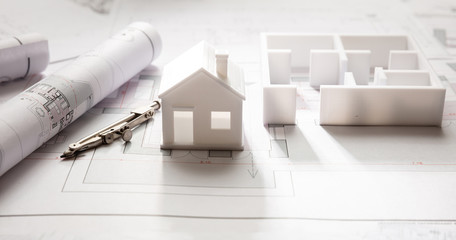 Residential building drawings and house model, Construction concept