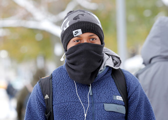 University student Demetrius Moncrease walks in the cold on campus in Detroit, Michigan,