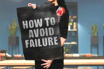 "The phrase "" How to avoid failure "" drawn on a black carton banner in woman hands. Woman in black dress and with black hair holds a cardboard with an inscription. Success. Entrepreneur. Business"