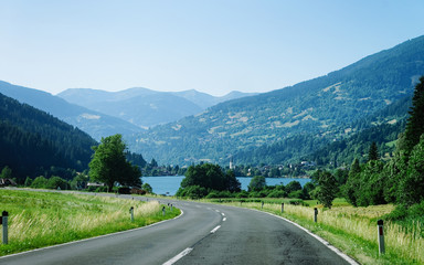 Car Road at lake Field am See of Carinthia of Austria. Landscape with motorway for rides and...