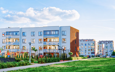Modern residential apartments and flats buildings exterior and outdoor facilities. New luxury house and home complex and green yard. City Real estate property and condo architecture. Empty background