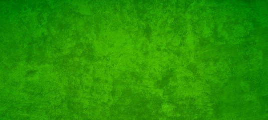 Old green Christmas background with distressed vintage texture and dark border grunge
