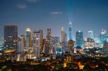 Fotomurales - Cityscape night view of Bangkok modern office business building