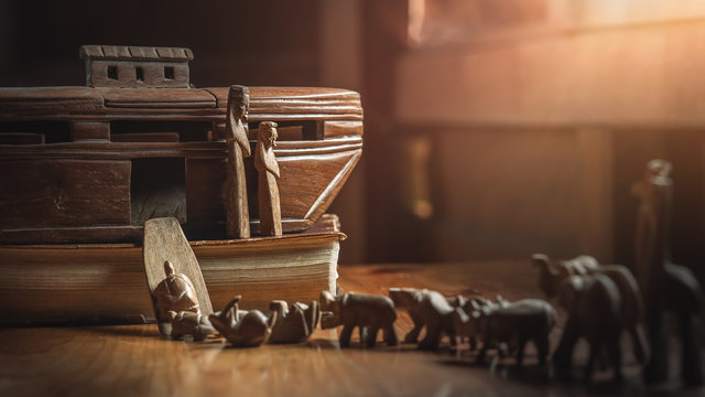 Noah's Ark with animals entering before great flood, story in Bible, Wood carving doll, christian concept.