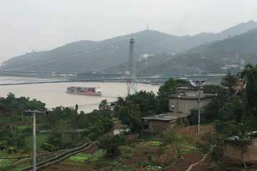 Container ship travels on the Yangtze river in the Three Gorges Reservoir region in Chongqing