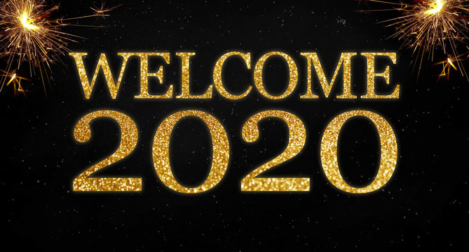 Golden glitter with the words welcome 2020 on black chalkboard background