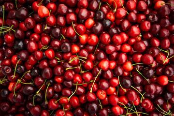 Foto auf Leinwand Kirschblüte Red Cherries. pile of ripe cherries with stalks.