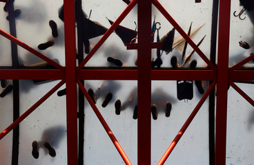 Protesters stand on a glass roof over the entrance to the Polytechnic University in Hong Kong