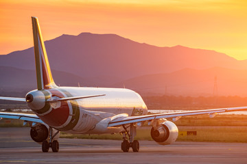 Cagliari, Italy 1-5-2017;  Alitalia A320 waiting to taxi at sunset in backlight