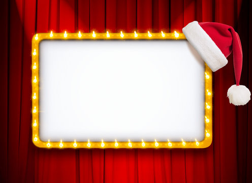 light sign with gold frame and Christmas hat on red theatre or cinema curtain
