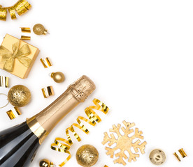 Sparkling wine bottle and Christmas golden decorations on white background