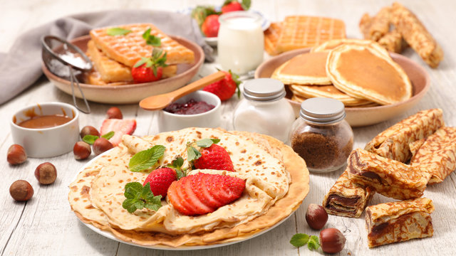 assorted of crepe, pancake and waffle with fruit and chocolate