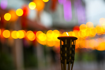 Small candle on blur light and bogey background at night. People will also decorate their houses,...